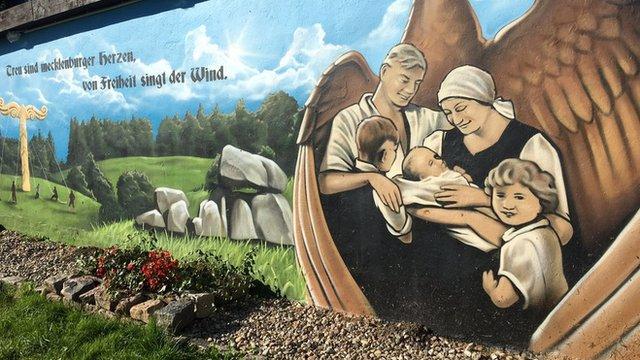 Mural of family in Jamel
