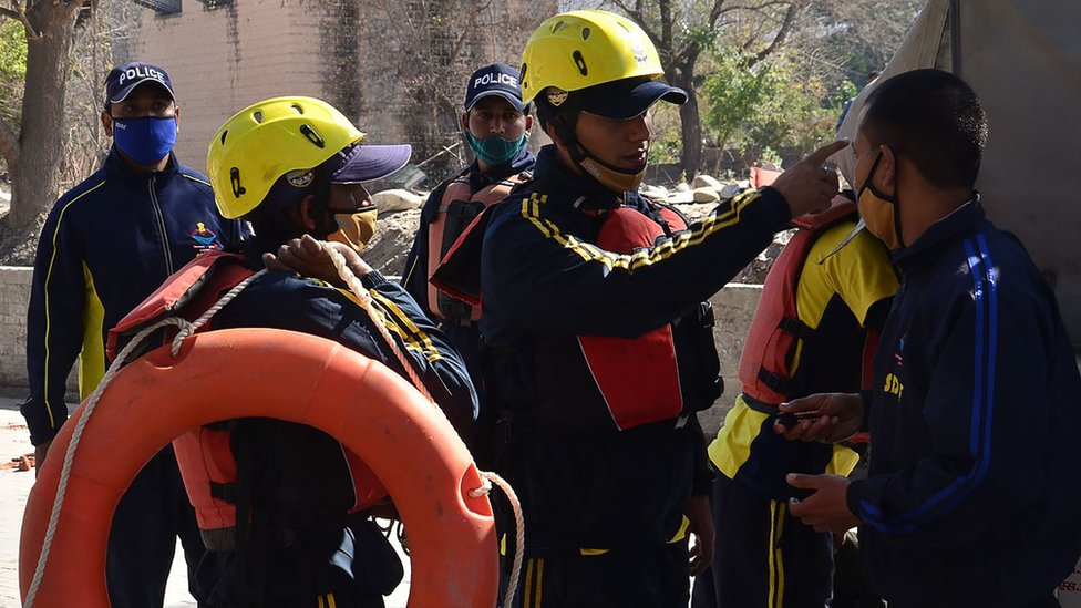 Image shows rescue workers in the region prepare for deployment