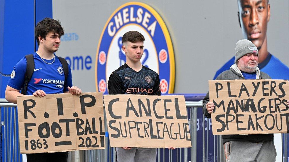 Chelsea fans protest about the European Super League outside Stamford Bridge
