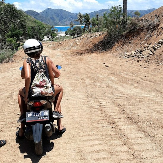 Sian on a motorbike.