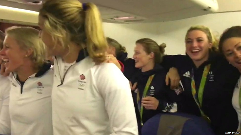 Some of Team GB singing the national anthem on the plane - still from footage filmed by Asha Philip