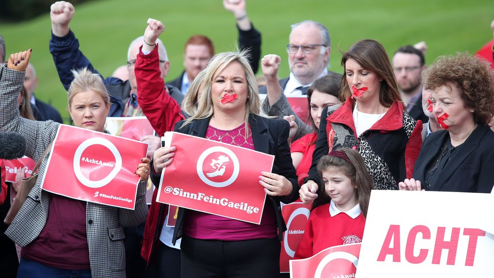 Sinn Féin's Michelle O'Neill with party colleagues and Irish language activists