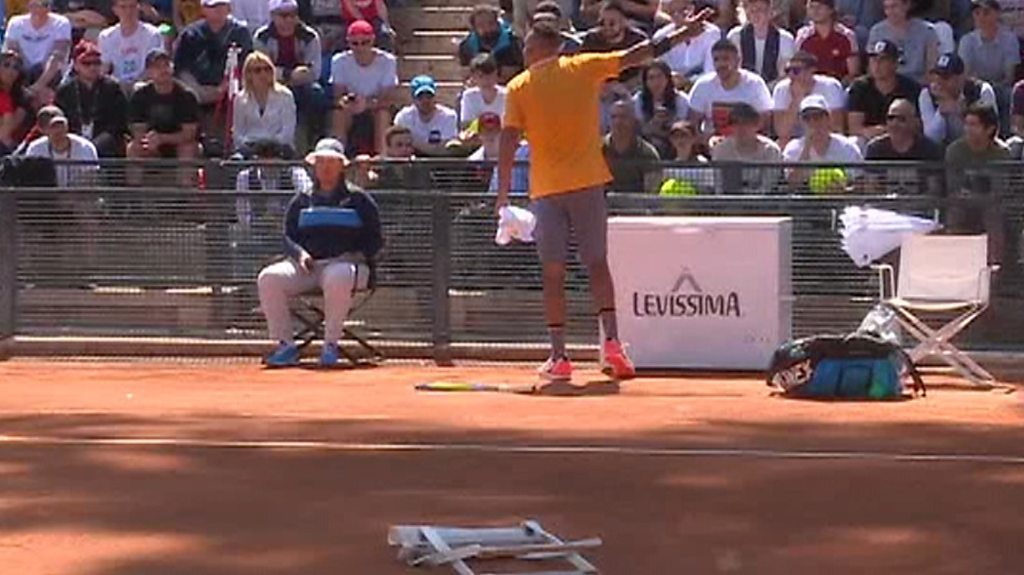 Watch Nick Kyrgios throw his racquet and a chair before walking off court and forfeiting match
