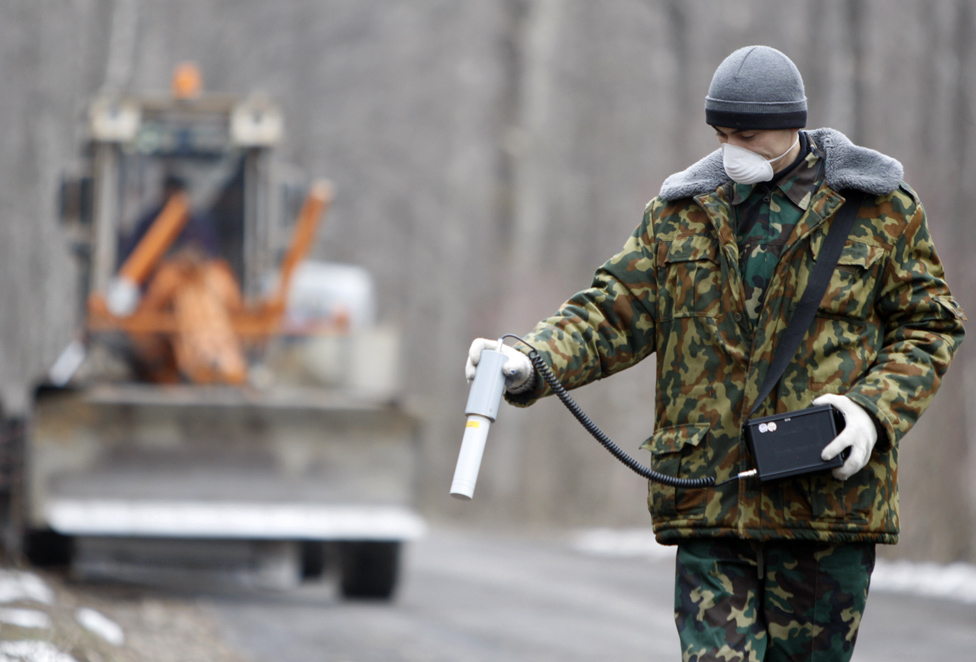 engineer Sergei Horloogijn as he carries out a radiation exposure survey in the state radiation ecology reserve near the 30km exclusion zone around the Chernobyl nuclear reactor, 2011