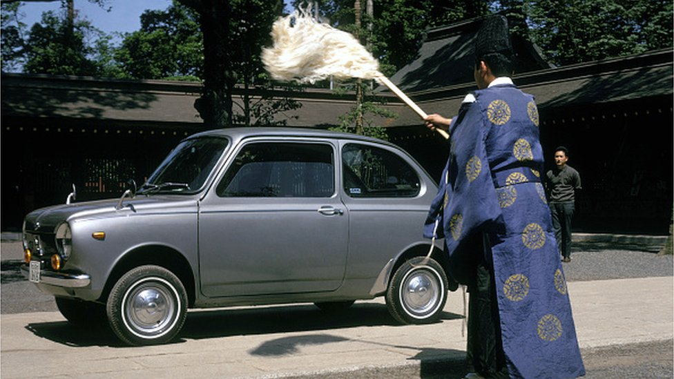 Japanese Shinto priest blesses a car