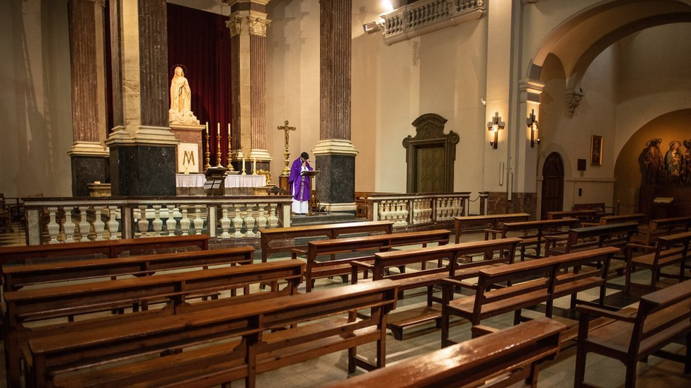 Priest Carlos Enrique Leal offers Mass via YouTube to parishioners at an empty Santa Maria de Betlem church on March 15, 2020 in Barcelona, Spain