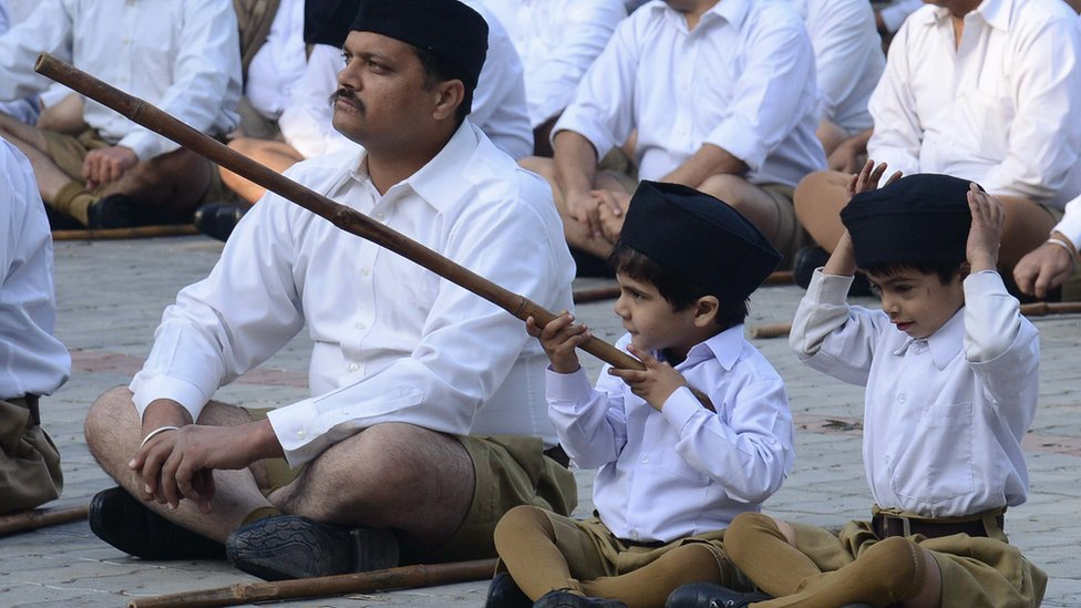 Indian volunteers of the Hindu nationalist Rashtriya Swayamsevak Sangh (RSS) listen to speeches before marching to mark the foundation day of the RSS, in Amritsar on November 10, 2013.