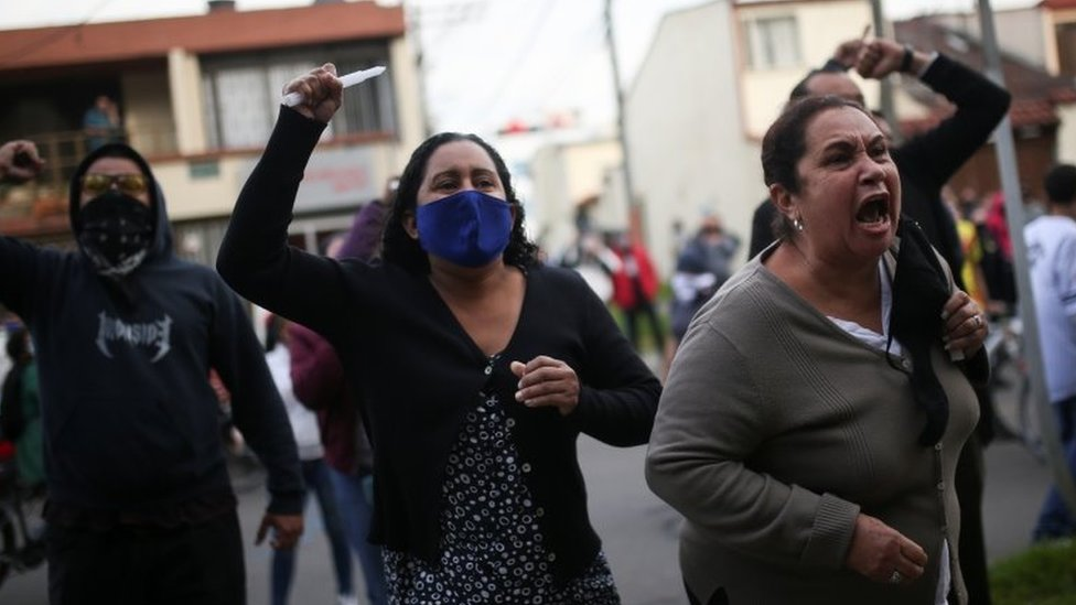 People protest outside a police station after a man, who was detained for violating social distancing rules, died from being repeatedly shocked with a stun gun by officers, according to authorities, in Bogota, Colombia September 9, 2020.