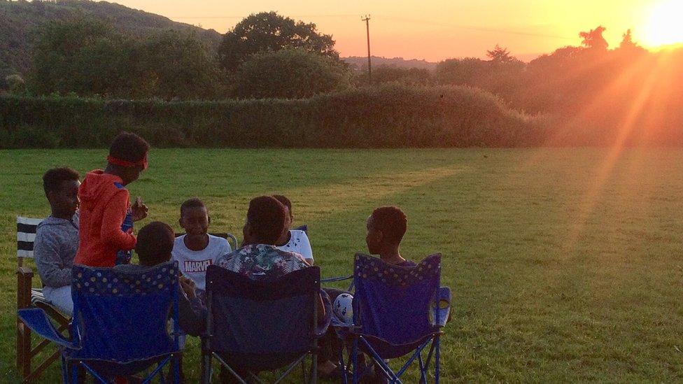 Children camping in a field