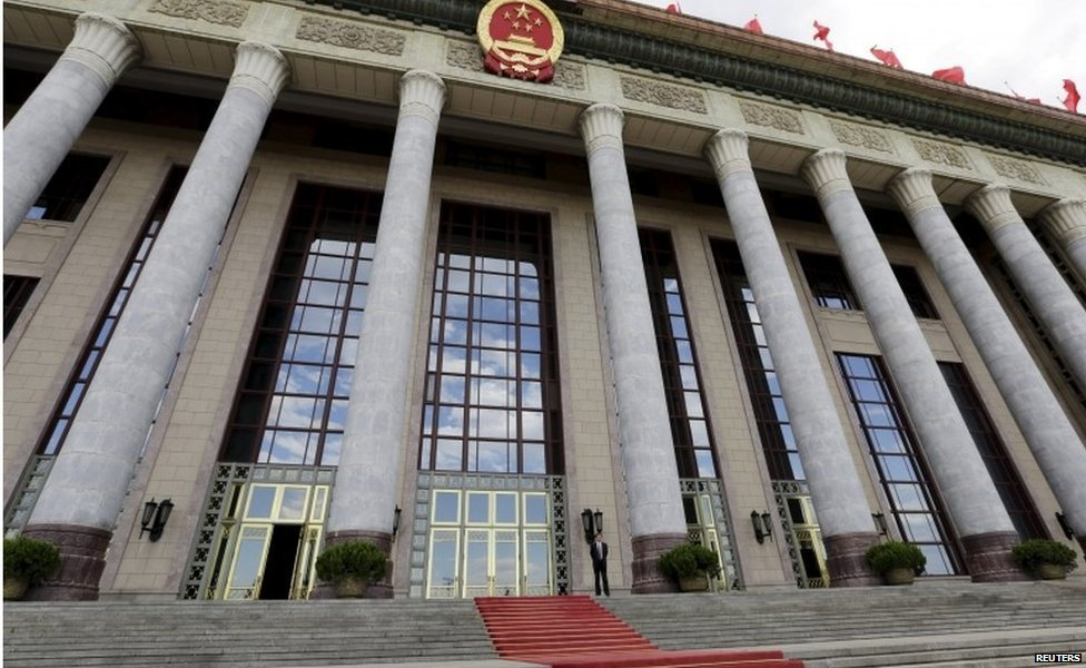 "An officer stands outside the Great Hall of the People, the venue of National People""s Congress, China""s parliament, in Beijing, June 18, 2015."