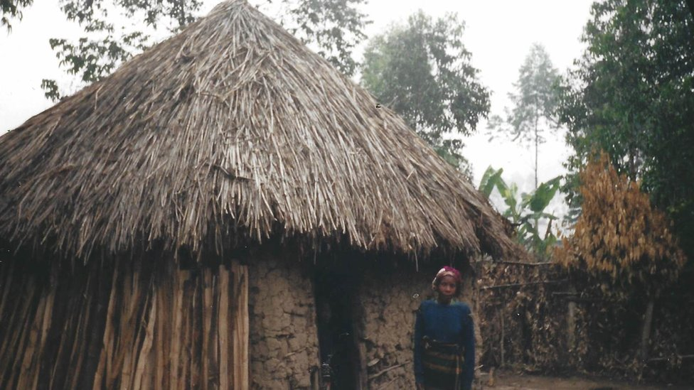 The thatched hut where Peter grew up in Uganda
