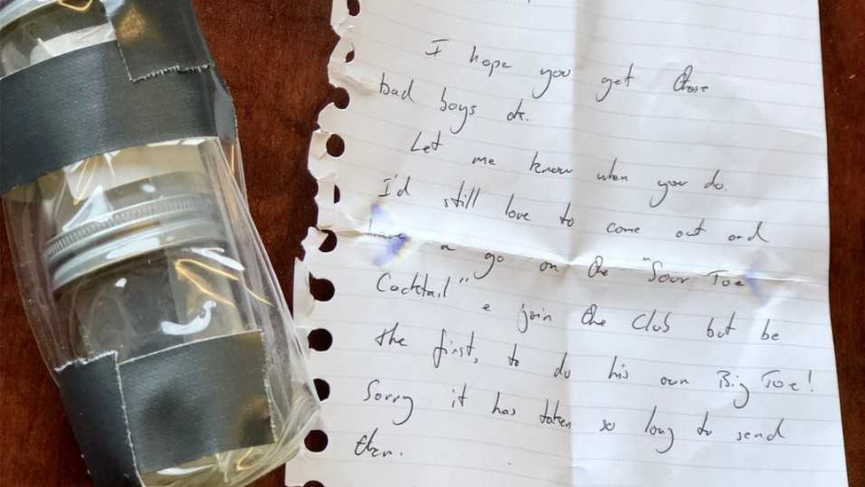 A handwritten note and packaged toes from Nick Griffiths
