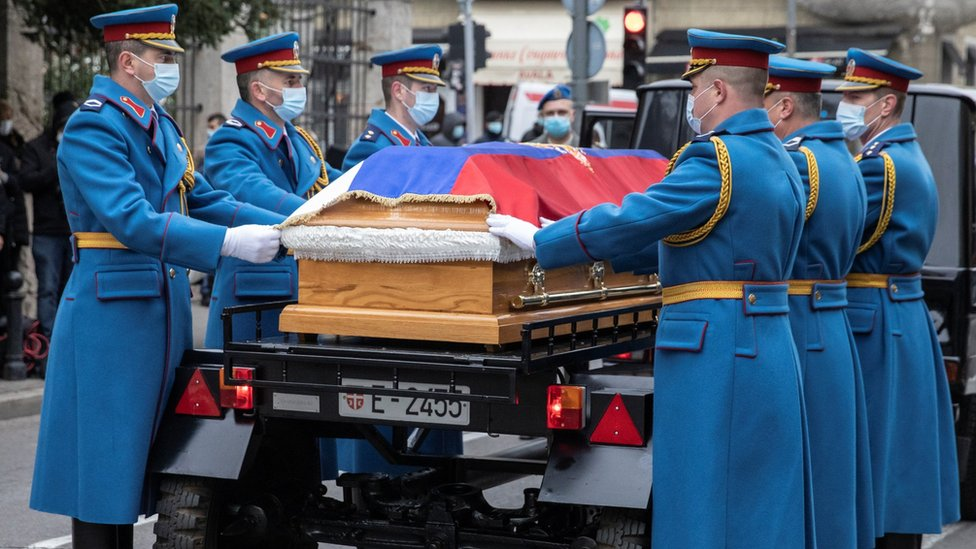 Serbian Army guardsmen carry the casket of Serbia's late Patriarch Irinej, who died after contracting COVID-19, in front of the Belgrade's Archangel Michael cathedral church, in Belgrade, Serbia, November 21, 2020.