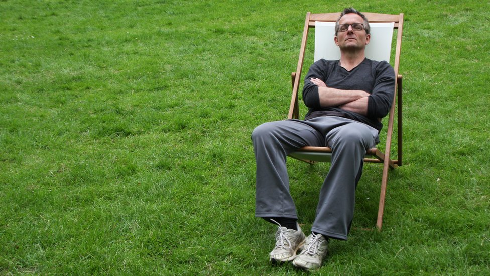 Michael Mosley in a deckchair with his eyes shut