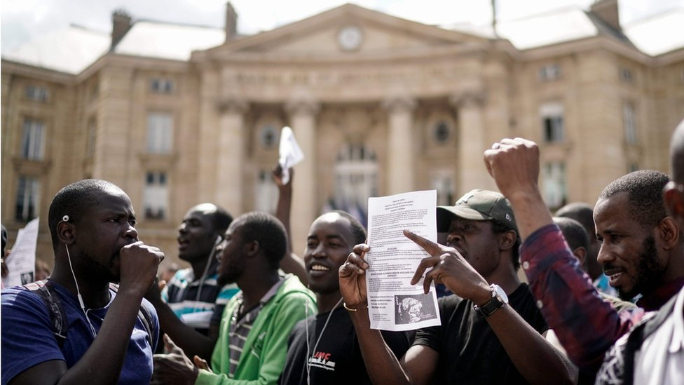 Undocumented migrants demonstrate in front of the Panthéon in Paris to ask for the regularisation of their situation