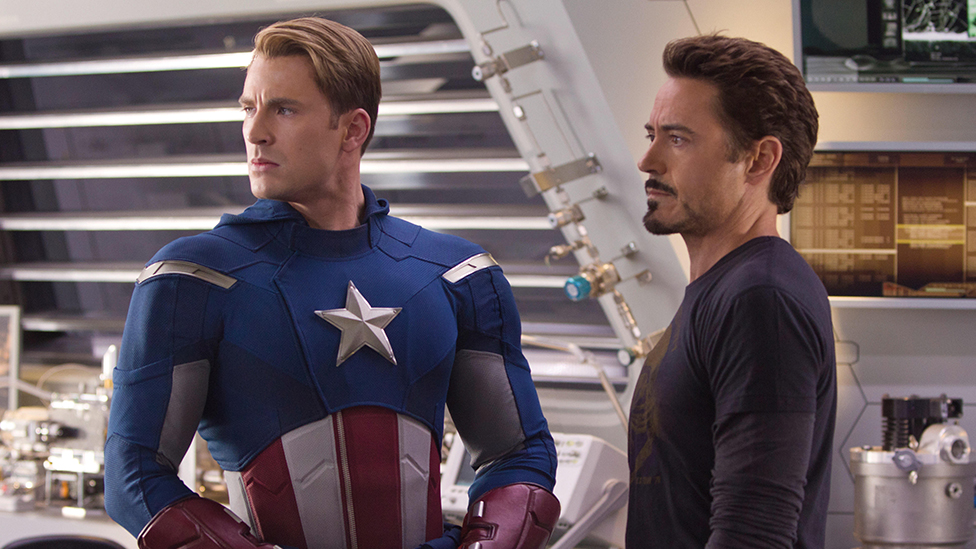 Chris Evans as Captain America and Robert Downey Jr as Tony Stark/Iron Man