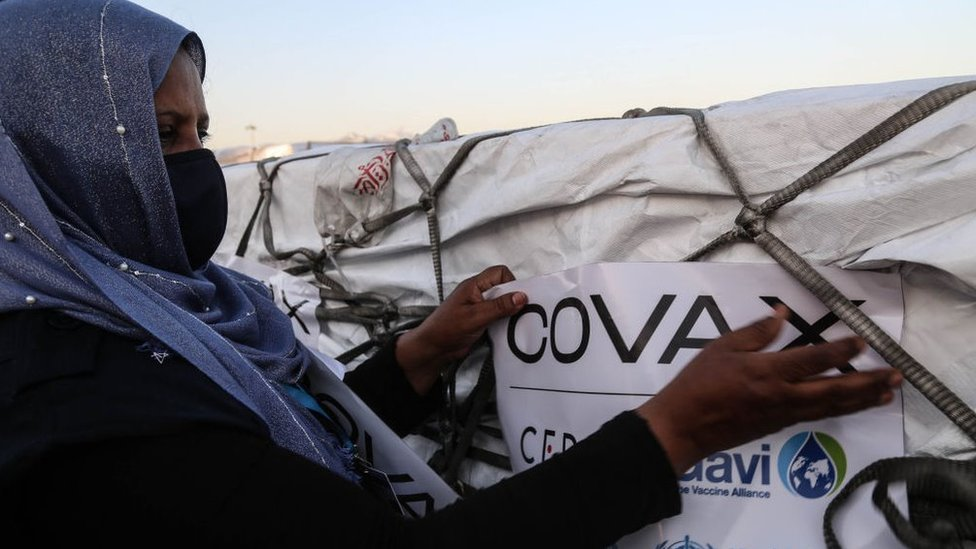 A woman dealing with a Covax delivery