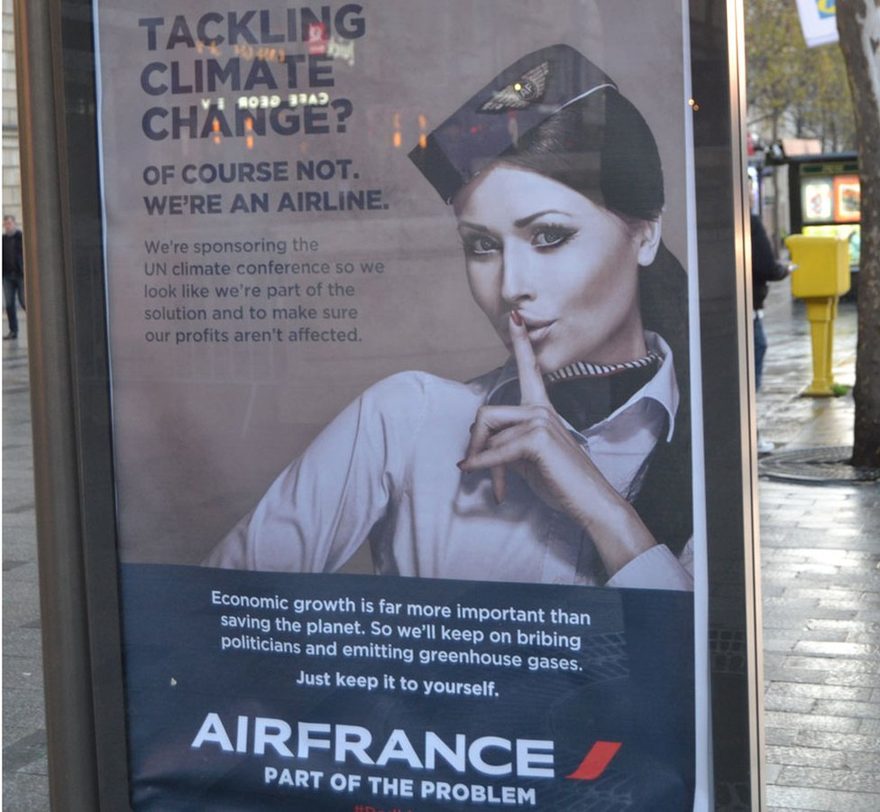 """A poster parodying Air France reads: """"Tackling climate change? Of course not, we're an airline"""""""
