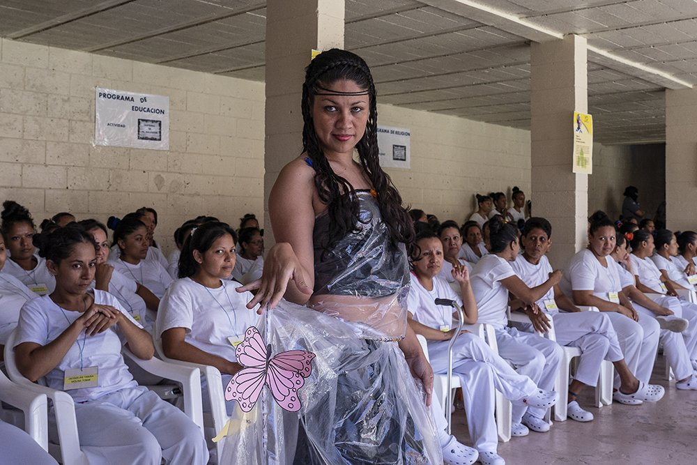 """Prisoners display their fashion creations as part of the """"Yo Cambio"""" or """"I Change"""" program, which attempts to rehabilitate prisoners, at the Penal Center of Quezaltepeque, El Salvador. November 9, 2018."""