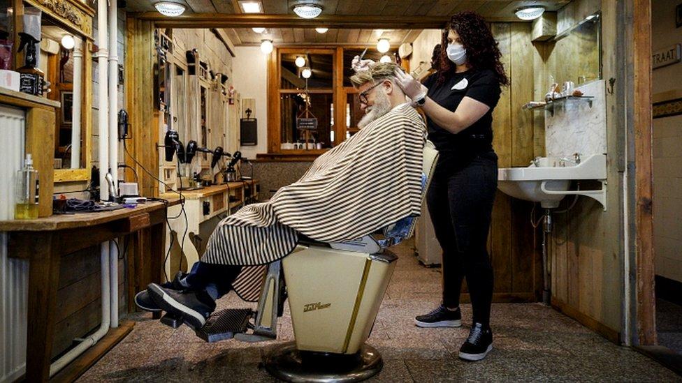 Hairdresser Robert Verhulst and his staff in Gouda