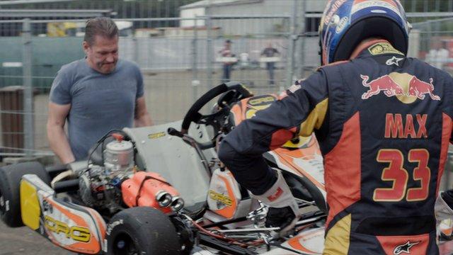 Jos and Max Verstappen carry a go kart
