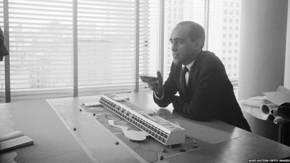 Brazilian architect Oscar Niemeyer discusses one of his designs, pictured on 3 June 1950. Original Publication : Picture Post - 4971 - Niemeyer: A South American Revolutionary