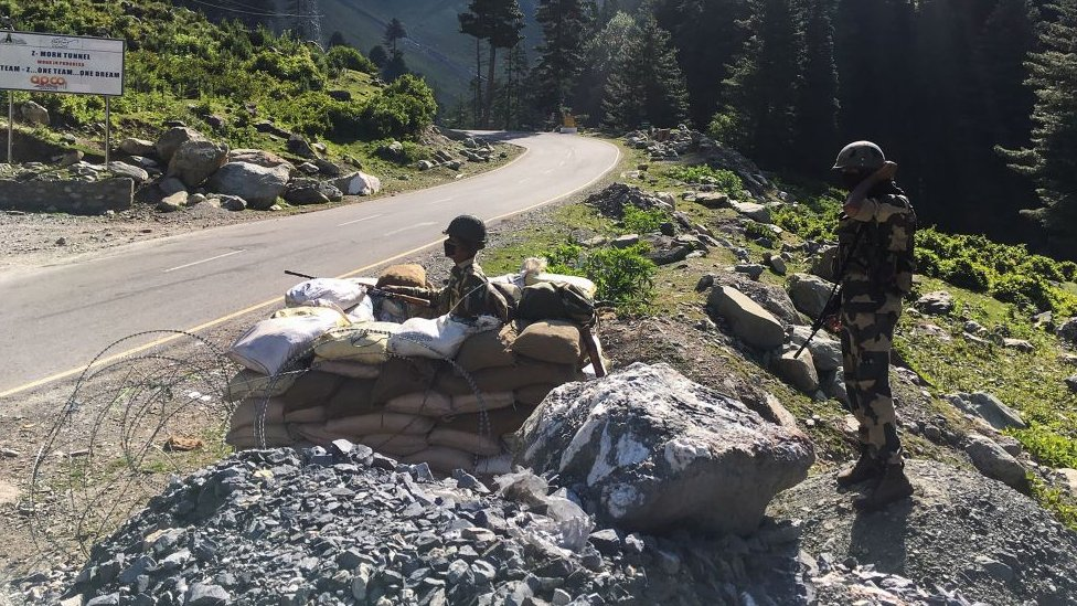 Indian Border Security Force (BSF) soldiers guard a highway leading towards Leh, bordering China, on June 17, 2020