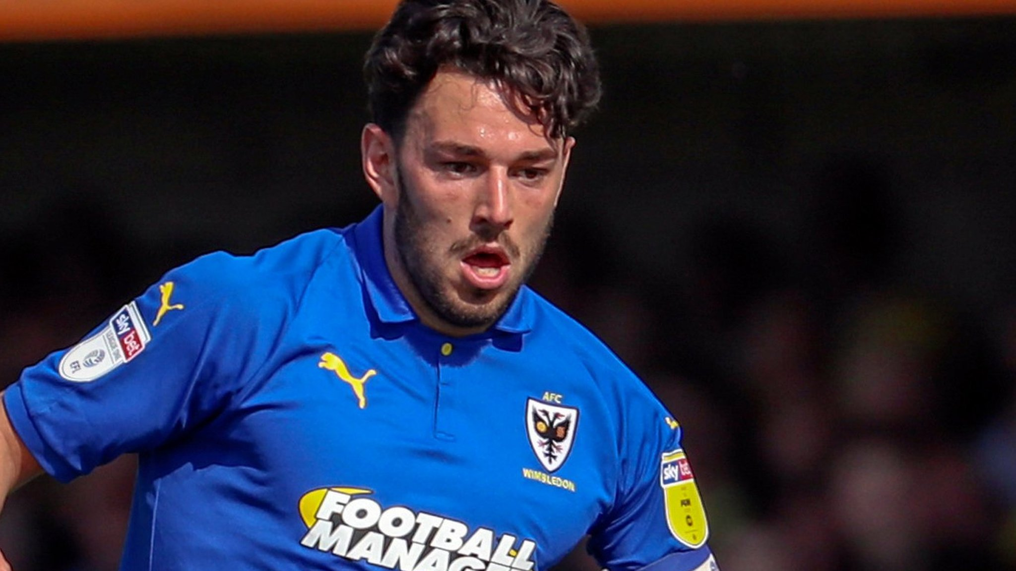 Will Nightingale: Defender extends stay at AFC Wimbledon
