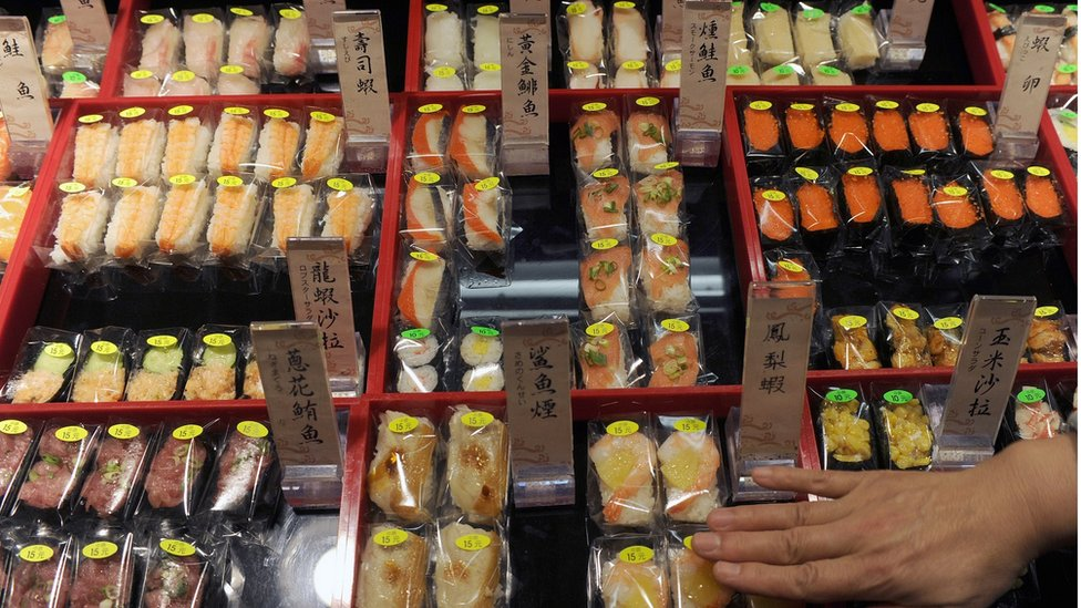 A supermarket worker places sushi in a shop in Hsintien, New Taipei City, on March 16, 2011. Asian diners are still tucking into sushi at restaurants around the region despite fears that elevated radiation levels in Japan could reach the food chain and contaminate raw ingredients.