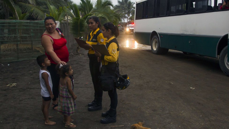 Residents of Boca de Pascuales, Colima State, Mexico, prepare to be evacuated on October 22, 2015, before the arrival of hurricane Patricia