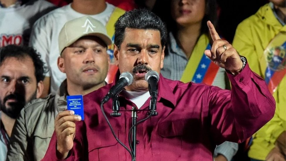 Venezuelan President Nicolas Maduro holds the political constitution after the National Electoral Council (CNE) announced the results of the voting on presidential election, on May 20, 2018, in Caracas, Venezuela.