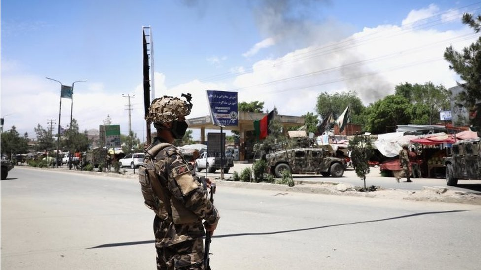 An Afghan soldier stands guard near the scene of an attack at an MSF (Doctors without Borders) clinic in Kabul, Afghanistan, 12 May 2020.