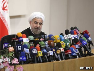 Hassan Rohani speaks with the media