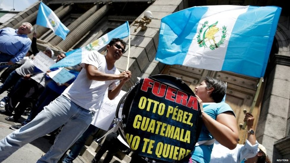Demonstrators yell slogans as they stand outside the Congress in Guatemala City on 1 September, 2015.