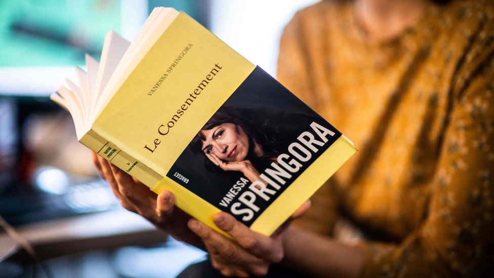 "A woman holds the book ""Le Consentement"" from French writer Vanessa Springora, in Paris on December 31, 2019"