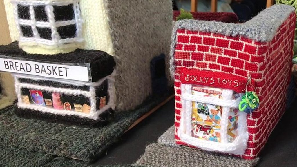 Thrapston nifty knitters knit their town's whole high street