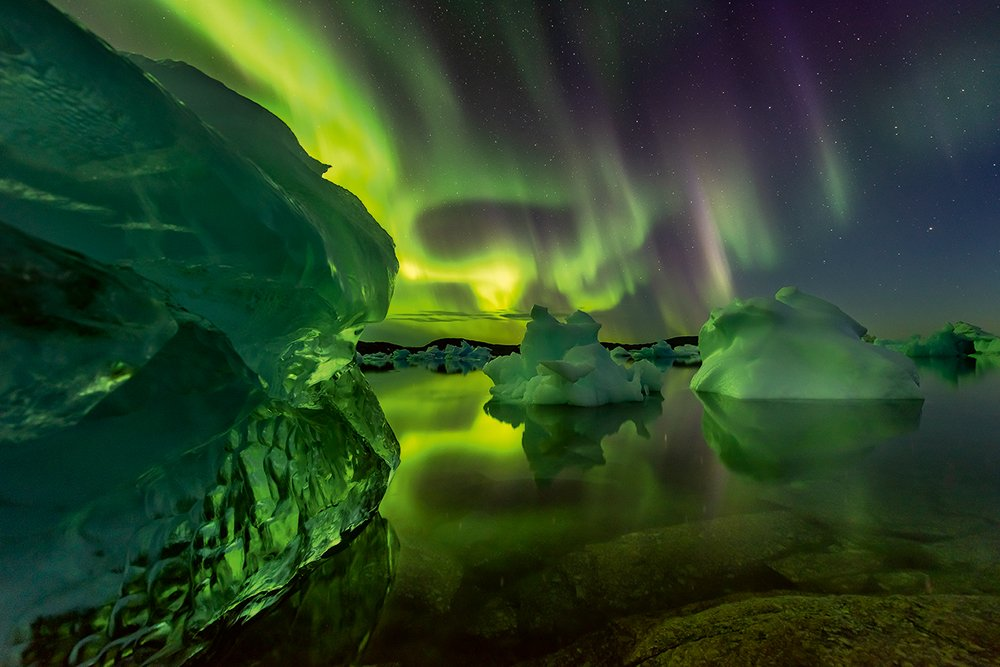 The northern lights seen above icebergs