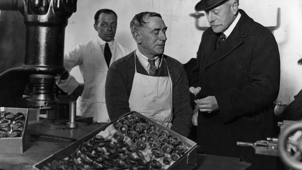 Earl Haig watches the stamping of poppies by ex-servicemen during a visit to the British Legion poppy factory at Richmond in 1926