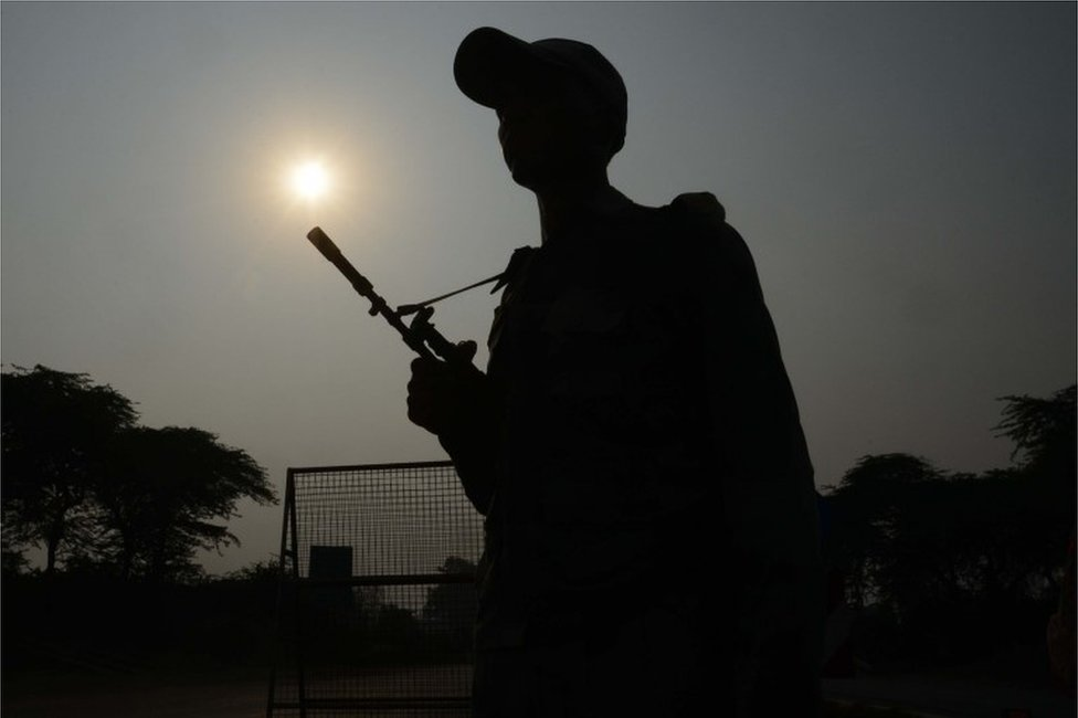 "Indian Border Security Force (BSF) personnel stand guard at the India-Pakistan Wagah Border, about 35 km from Amritsar on September 29, 2016, after the Punjab state government issued a warning to villagers to evacuate from a 10 km radius from the India-Pakistan border. Indian commandos carried out a series of lightning strikes September 29 along the de facto border with Pakistan in Kashmir, provoking furious charges of ""naked aggression"" from its nuclear-armed neighbour."