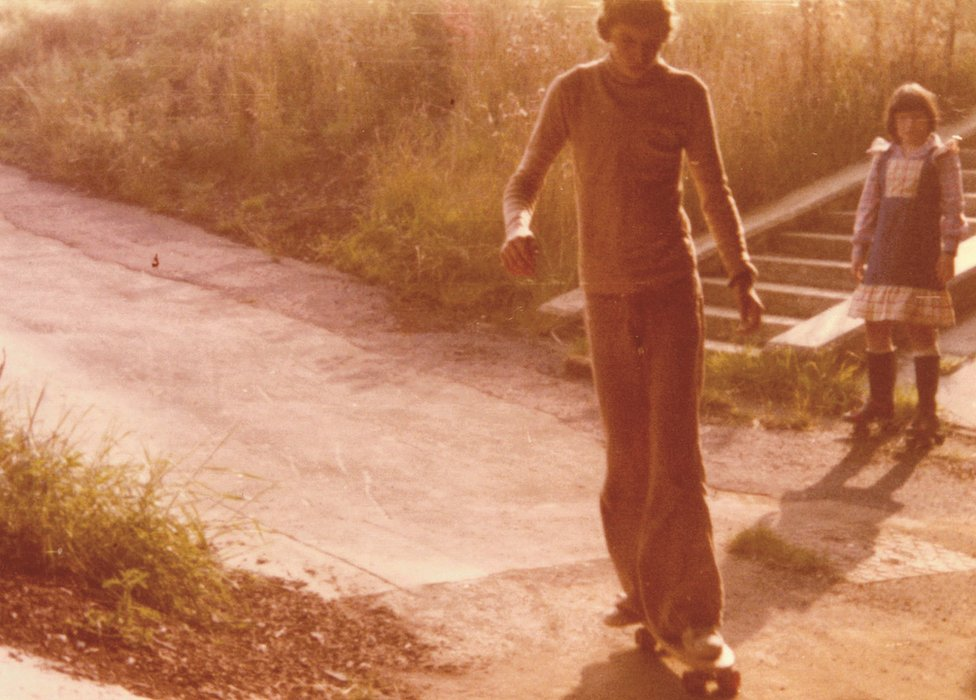 Boy skateboarding in 1970s