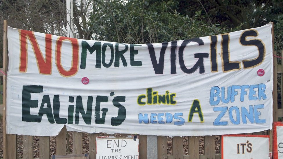 Banner that reads 'no more vigils' outside a clinic in Ealing