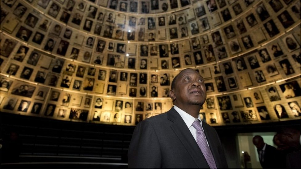 "Uhuru Kenyatta, looks up and around at the photographs in the conical shaped ""Hall of Names"", during a ceremony to honor the six-million Jews who perished at the hands of the Nazis during the Holocaust of World War II, in the Yad Vashem Holocaust memorial museum in Jerusalem, Israel, 23 February 201"