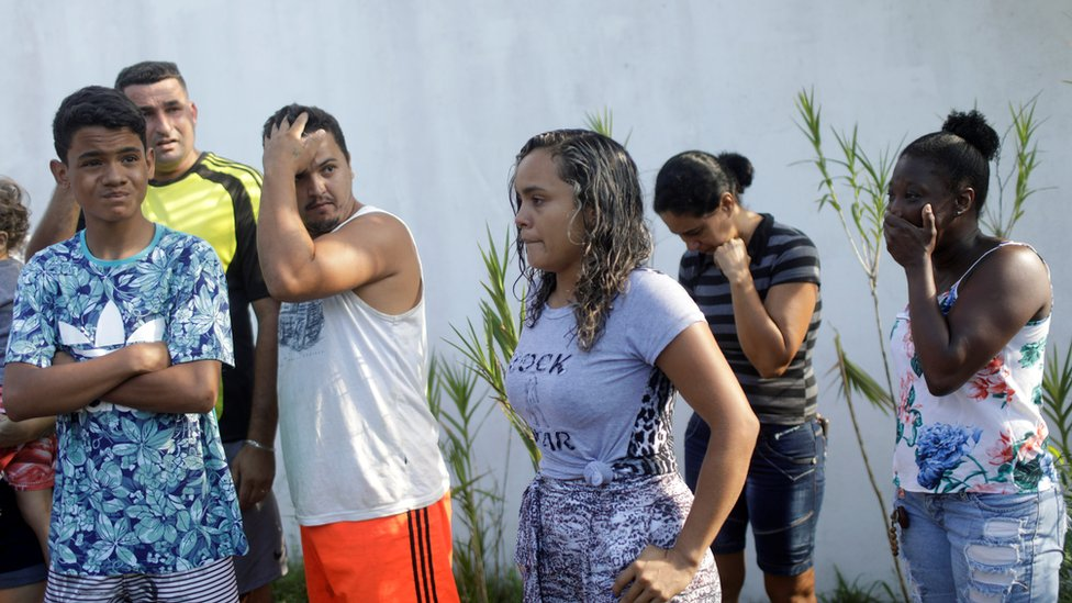 "People wait for information in front of the training center of Rio""s soccer club Flamengo, after a deadly fire in Rio de Janeiro, Brazil February 8, 2019"