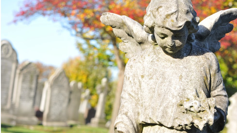 graveyard with stone angel
