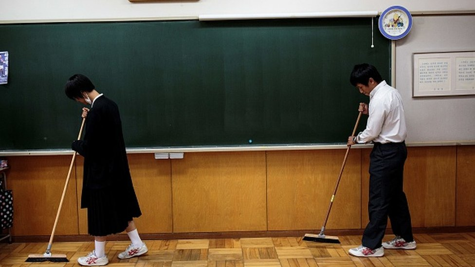 Students sweep their classroom at a Japanese school