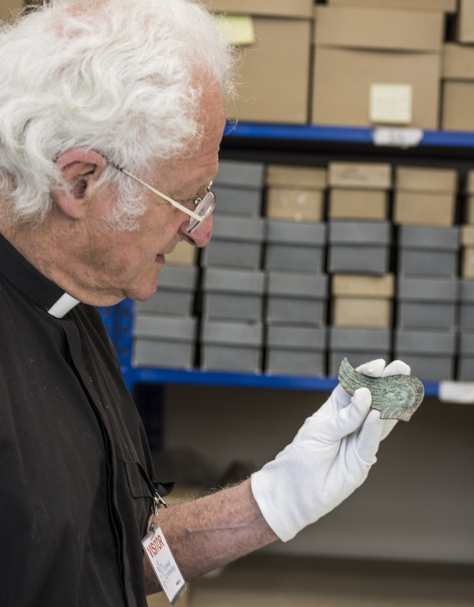 Dr Martin Henig studying the wing