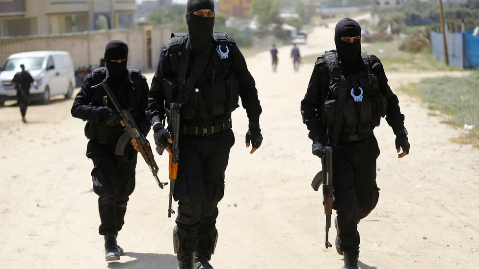 Hamas security forces carry out a raid in Nuseirat, south of Gaza City, on 22 March 2018