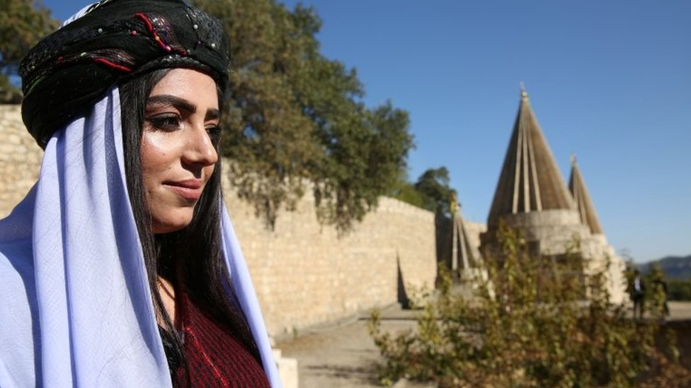 A woman arrives for the inauguration ceremony of the new Yazidi spiritual leader in northern Iraq