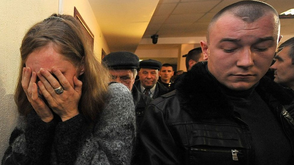 A woman cries after a family member is sentenced to death in a Belarus court