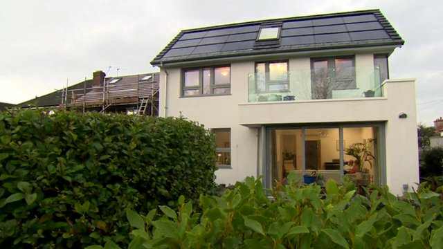 The front of a a house which costs just £15 ($23) per year to heat, light and power